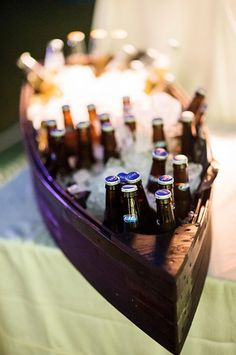 Bottled beers chilling in a canoe. By Paul Johnson Photography