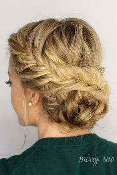 Twist a fishtail braid and a French fishtail into a bun at the nape of your neck to make this elegant updo. As always, Missy Sue provided a helpful video tutorial to assist you in re-creating this look.