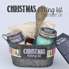 Gift basket idea: A Christmas Baking Kit in a Tin! Put sprinkles, cookie mix, a cookie cutter, a wooden spoon and an apron in a pretty tin for a great gift idea. Comes with free printable labels and tags!