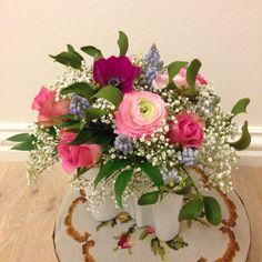 Pastel coloured bouquet with a misteltoe.