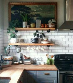 Wood counter tops and metro tiles. great kitchen