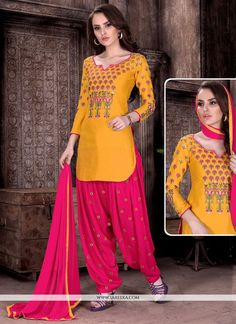 Make the heads flip after you dress up with this hot pink and mustard cotton   patiala suit. The ethnic embroidered work to your apparel adds a sign of splendor statement for the look. Comes with matc...