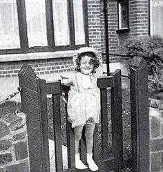 Young Maggie, age three, outside her house in Ilford Maggie Smith Young, Ian Smith, Kenneth Williams, Albus Dumbledore, Downton Abbey, The Outsiders, Age 3, Candid, Shots