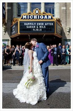 This bride and groom were married at the Historic Michigan Theater in Downtown Ann Arbor, Michigan.    Photo:  JLB Photography #puremichigan