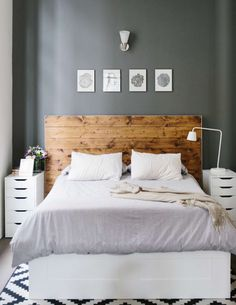 wooden headboard, grey walls, white linens | all white bedroom #neutral #loft #modern