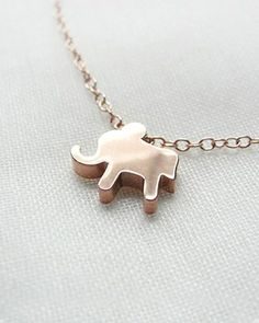 A cute little gold elephant necklace.  They sure are the thing right now.  This one is darling!!