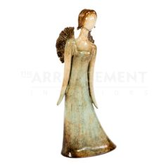 Vivian Angel Pottery  An exquisite handmade pottery piece that is a unique and traditional work executed in a modern style. Bring style and elegance to your home with this angel showing off her wings.
