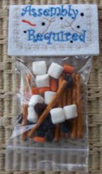 Fill with marshmellows, raisins, orange tic tacs and pretzel sticks to 'assemble' a snowman