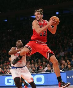 Joakim Noah #13 of the Chicago Bulls pulls down a rebound in the game against the New York Knicks at Madison Square Garden on December 21, 2012 in New York City.