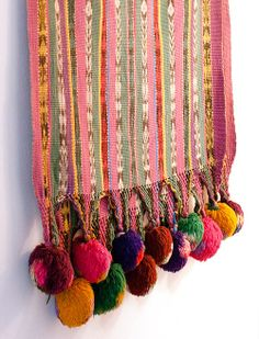 A V - via - Design Sponge - incredible pom pom shawl from Guatemala ( lizzie & kathryn fortunato )