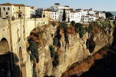 "Ronda was heavily affected by the Spanish Civil War, after which much of the population emigrated elsewhere. The famous scene in Chapter 10 of Hemingway's ""For Whom the Bell Tolls"", describing the 1936 execution of Fascist sympathisers in a (fictional) village who are thrown off a cliff, is considered to be modeled on actual events at the time in Ronda."