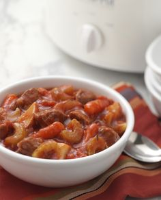 This Slow Cooker Beef Stew is cooked to perfect with onion, celery, carrots and potatoes layered on top.