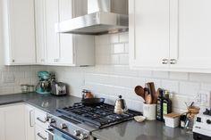 Crisp white kitchen design featuring Larkin hardware by Rejuvenation