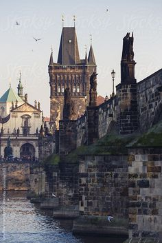 Prague - The Charles Bridge seen from the Vltava River bank.  by Geoffrey Hammond