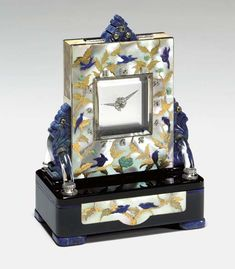 A RARE ART DECO MULTI-GEM AND MOTHER-OF-PEARL MYSTERY CLOCK, BY BLACK, STARR & FROST - Christie's
