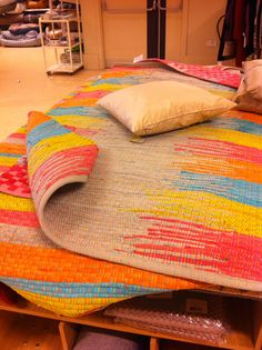 Super bright rag rug to open up the living room or study - complements the throws. TKMaxx / Homesense