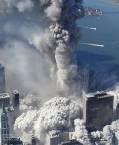 The moment one of the World Trade Centre towers begins to crumble in New York  Read more: http://www.dailymail.co.uk/news/article-1249885/New-World-Trade-Center-9-11-aerial-images-ABC-News.html#ixzz32O1idMLt  Follow us: @MailOnline Pics on Twitter | DailyMail on Facebook