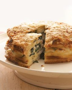 """Spinach Gruyere Gateau de Crepes: Martha Stewart Living """"A winsome way to use leftover crepes, this towering gateau de crepes replaces the usual jam, cream, and chocolate with alternating layers of rich bechamel and sauteed spinach. Crepe Recipes, Brunch Recipes, Breakfast Recipes, Mexican Breakfast, Pancake Recipes, Brunch Menu, Breakfast Sandwiches, Breakfast Pizza, Waffle Recipes"""