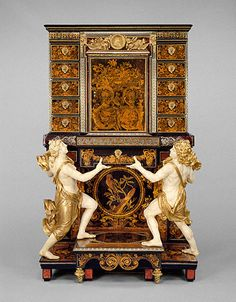 Cabinet on Stand -  Attributed to André-Charles Boulle  French, Paris, about 1675 - 1680  Oak veneered with ebony, pewter, tortoiseshell, brass, ivory, horn, and various woods; with drawers of snake wood; painted and gilded wood figures; bronze mounts