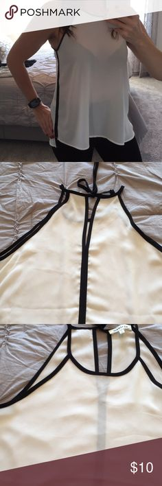 Monteau Cream and Black Sleeveless Top Super cute!  Cream and Black.  Ties at the back and black trim detail all over and down the sides.  New without tags!  Smoke free home! Monteau Los Angeles Tops Blouses