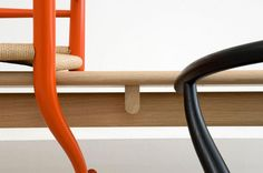 Curves and balance The Wishbone in Orange from Carl Hansen.