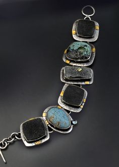 Patricia McCleery: link bracelet with black and turquoise gems set in silver with 22K gold accents
