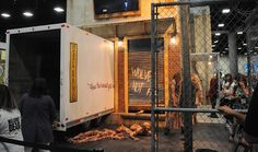 Con-goers visiting the booth this year will experience Noah's blood-soaked revolving door, the napalmed walkers from Atlanta and the Wolves' food warehouse walker trap.