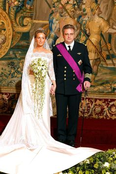 No. 25 British-born Claire Coombs married Prince Laurent of Belgium in a non-extravagent but charming chantilly lace production by designer Édouard Vermeulen. Absolutely no offense to Mr. Vermeulen, but making up this bride is the antique veil supplied by the Belgian royal family. Brussels, Apr 2003