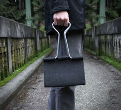 The clip bag is a purse or hand bag that looks just like a black metal binder clip from your office. Designed by Seattle based designer Peter Bristol, the clip bag is made from wool felt and aluminum ...