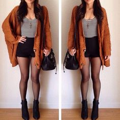Burnt orange cardigan, black & white striped top, black high-waisted shorts.