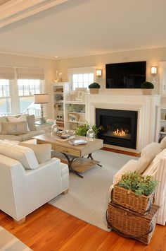 Gorgeous coastal family room. I love the built-ins under the windows.