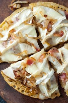 A gluten free gourmet pizza dream come true! Pear, Brie, Caramelized Onion, Bacon Socca Pizza with Fig Jam is sweet, creamy, and savory recipe all wrapped up in one meal! Gluten free as well as gluten full noshers will all be happy with this recipe! www.mamagourmand.com