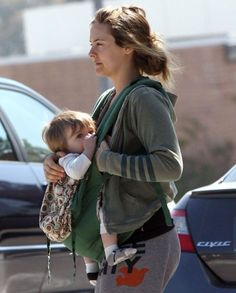 Alicia Silverstone breastfeeding her little one in an ERGO (River Rock Organic)