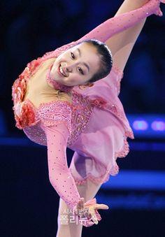 Figure Skater, Mao Asada smiles during gala performance.