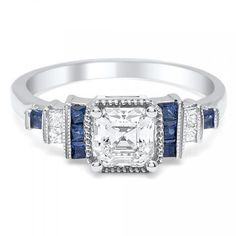 Moyer Jewelers: Diamond Jewelry - 14KT WHITE GOLD STEP STYLE DIAMOND AND SAPPHIRE RING WITH CHANNEL SET SIDES