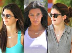 """wearing matching necklaces that say """"Mason Hearts Penelope."""""""