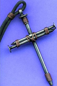 Nail-Cross-Pendant - it's made from nails and wire, but mine weren't as polished as the one in the picture, which has copper wire and a welded loop on top. - no complete tutorial