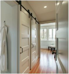 5 Panel Doors barn doors interior - lower level bath. top panel frosted glass for natural light?