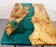 FREE SHIPPING on this Turquoise Resin river dining table with a touch of glow in the dark pigment, this is a small dining table which is 50 long x30 wide and 30 high this table is sold but it is a good example of a different color that I do! The price goes up or down depending on