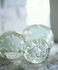 Glass orbs reflect the seaside glow.