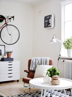 Bike in the living room - via Coco Lapine Design