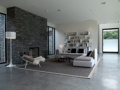 :: INTERIORS :: designer Barbara Hill Design, simple tone on tone colour palette plays well with the stone and concrete floors #interiors #livingroom