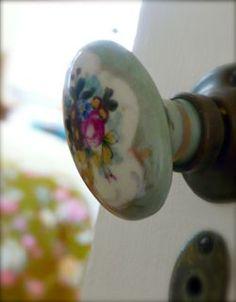 Sweet porcelain doorknob at the quaint little cottage.