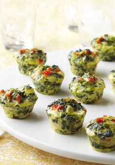 Mini Spinach-Artichoke Frittatas -- A favorite pairing--spinach and artichokes--gets whipped together into tasty bite-size frittatas in this recipe. Make them ahead and reheat just before your guests arrive.