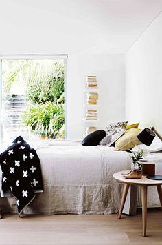 vertical bookshelves, natural light, simple beauty / insideout