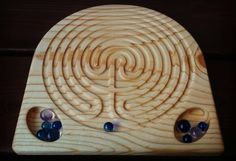 Montessori and Waldorf Inspired Lessons and Activities by MontessoriReStore Labyrinth Design, Labyrinth Maze, Labyrinth Garden, Finger, Labrynth, Ancient Symbols, Line Design, Ceramic Pottery, Etsy Seller