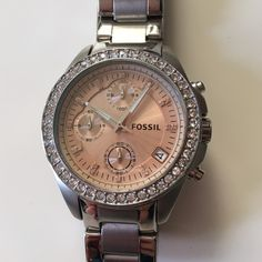 NWOT Fossil ladies boyfriend style crystal watch Received as a gift never worn beautiful steel boyfriend style chronograph watch with pink face, pink crystals around it and a pink crystal at every hour. In perfect working order. Fossil Accessories Watches