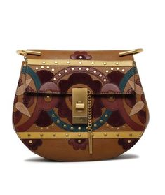 Chloé Drew Small Caramel Studded Floral Patchwork Calfskin Leather Cross Body Bag. Get the trendiest Cross Body Bag of the season! The Chlo Drew Small Caramel Studded Floral Patchwork Calfskin Leather Cross Body Bag is a top 10 member favorite on Tradesy. Save on yours before they are sold out!