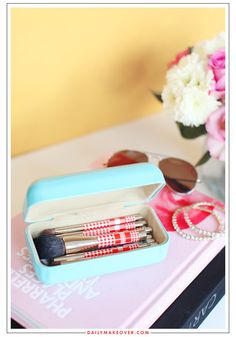 Use a large sunglasses case to store makeup brushes - great way to keep them clean/dust free, and perfect for on the go :)