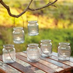 """JELLY JAR TEALIGHT LANTERNS S/6--On porch or patio now, clustered at fireside later, authentic fluted glass jelly jars become nostalgic little tealight lanterns hung from copper-finished wire bales. Imported. Each 4 oz., 3"""" Dia. x 4""""H."""